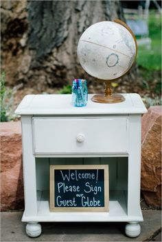 Use a globe for your guest book. Captured By: Emily Elizabeth Photo ---> http://www.weddingchicks.com/2014/05/30/wild-and-free-bohemian-wedding/