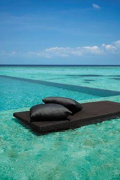 Turquoise infinity pool at Shangri-La Villingili villa in Maldives