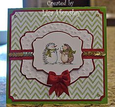 handmade Christmas card ... the cutest snowman EVER! by ponygirl40 ... luv how she turned one of the hedgehogs into a snowhog ... gorgeous bow ... luv the layered labels dies with thin red mats and a wide margin between the two ... great design for other themes too ... Stampin' Up!