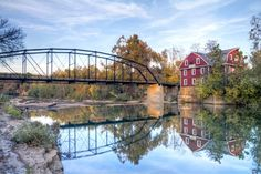 War Eagle Bridge ~ near Rogers, AR.  Built in 1908, it crosses the War Eagle River where a working grist mill still stands