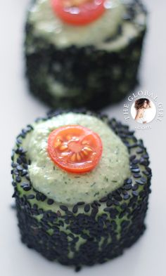Cucumber rolls with raw vegan herbed cashew cheese and black sesame seeds. This healthy snack is raw, vegan, dairy free and gluten free.