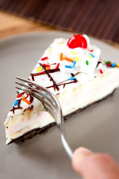 No Bake Banana Split Desset Cheesecake: 3 Layers of silky smooth cheesecake topped off with hot fudge and whipped cream. This no bake summer dessert tastes just like a banana split and is nearly foolproof!