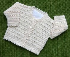 Beautiful crocheted baby sweater.