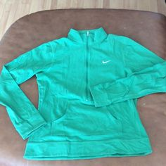 Nike Half-Zip.  Like new! Cotton/Spandex Nike pullover.  Banded bottom, front pouch pocket, half-zip.  Soft and comfy! Nike Tops Sweatshirts & Hoodies