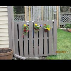 Old palette fence to hide garbage cans :)