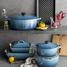 A COLOURFUL KITCHEN! Bring the beauty of the sea into mom's kitchen with the new Marine Blue Le Creuset collection available exclusively at Williams-Sonoma for a limited time. See in-store at 2903 Granville St, Vancouver. Kitchen Dishes, Kitchen Items, Kitchen Gadgets, Kitchen Dining, Kitchen Appliances, Teal Kitchen Decor, Kitchen Stuff, Kitchen Tools, Le Creuset Cookware