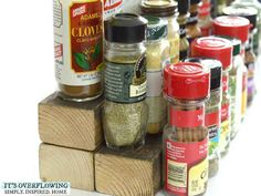 Use three small pieces of wood to make your spices easy to see in your cabinet.