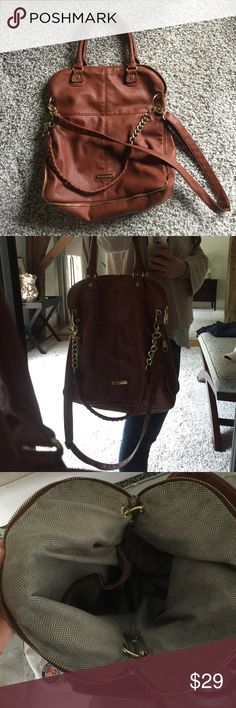 Steve Madden brown leather gold zipper get purse Pre loved but still in great condition. This bag is a light brown faux leather with gold zipper and chain details! It's really roomy and is perfect as a travel carry on or for an reason you need a larger bag!! Has a long strap for cross body or short handles to hold as a purse or on shoulder Steve Madden Bags Crossbody Bags