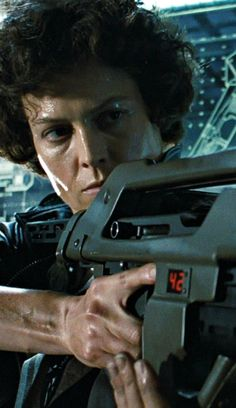 "Sigourney Weaver kicking ass and taking names in ""Aliens."" Excellent flick, terrific pacing."