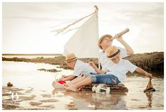 Boys at beach on a wooden sail raft