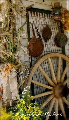porch decorating Wagon Wheel and Bed Spring Used as Rustic BackdropWagon Wheel and Bed Spring Used as Rustic Backdrop Rustic Gardens, Outdoor Gardens, Old Wagons, Rustic Backdrop, Bed Springs, Autumn Garden, Porch Decorating, Decorating Ideas, Yard Art