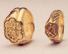 Left one: set with a ruby on each shoulder and has engraved the coat of arms of the Grailly family. Late 14th century. Right one: French, 15th century, engraved with a saracen`s head.
