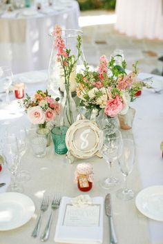 #roses #menus #centerpiece Photography by lanedittoe.com Floral Design by floraloccasions.com/  Read more - http://www.stylemepretty.com/2013/07/03/villa-san-juan-capistrano-wedding-from-lane-dittoe-fine-art-wedding-photographs/