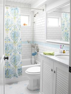 Pretty bathroom. Love the subway tile, floor, vanity & shower curtain. House of Turquoise: Waterleaf Interiors