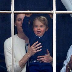 Prince George, who is expected on the blacony of Buckingham Palace later today in his first official appearance on British soil, is pictured smiling at the windows of Buckingham Palace today as the traditional Trooping the Colour parade takes place outside via DailyMail 06.13.15