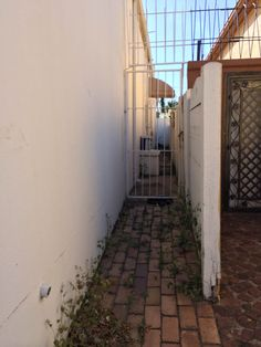 Needs better security. Matching gate to entrance gate. Wall needs security