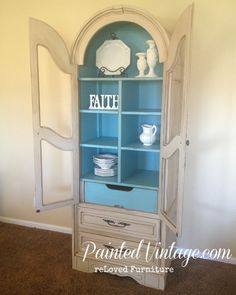 Hutch Makeover Reveal - I just love the blue contrast inside.