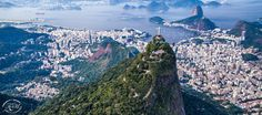 View Above Rio - Aerial view of Christ the Redeemer overlooking Sugarloaf and Rio de Janeiro.