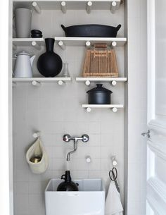 Clever twist on otherwise blah shelves: round peg supports!