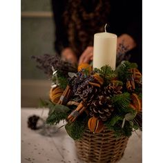 This Christmas table arrangement is easy to make. Get a basket or ceramic bowl and fill with wet oasis. It's nice to stick to one colour palette, and keep that going throughout the house - pretty & simple.
