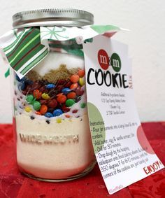 M&M Cookie Mix in a Jar Recipe  - Make this easy cookie in a jar mix with just one stop at our bulk bins! A Mason jar filled with pre-measured ingredients for friends! Gift the jar, and the recipient only needs to add the wet ingredients and bake! Includes printable gift tag!