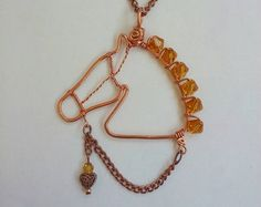 This yoga pose necklace is hand formed from a single piece of natural copper wire. It is approximately 1 high, from head to toe. :) The pendant is shown on a red faux suede cord. Buyer can choose between, brown, or black faux suede or pure copper chain. All necklaces are made with a lobster clasp and are 20 in length unless another length is requested. *Please indicate your choice of necklace and preferred length in the NOTE TO SELLER upon purchasing. If no choice is made, the pendant will…