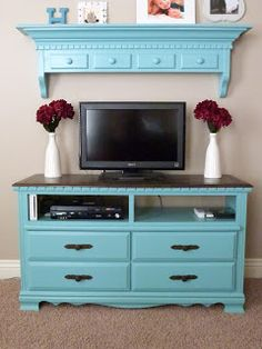 CraftyMomz: Old Dresser = Entertainment Center!!! Excellent framing with the matching mantle above the tv.  could work with a low placed wall mounted tv also.