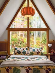 I'm swooning over the windows and design in this A-frame.