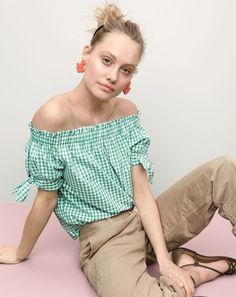 J.Crew women's off-the-shoulder top in gingham, boyfriend chino pant, beaded flutter earrings and knotted suede sandals.