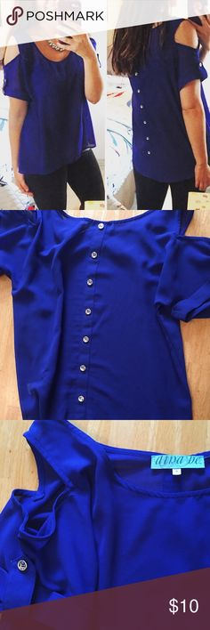 Francesca's Blue top w/ buttons down the back The shirt has buttons and is also longer in the back. There are openings at the shoulders and a cute little pocket on the upper left. Gorgeous blue color. I always get compliments on it. Francesca's Collections Tops Blouses