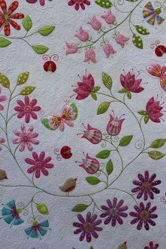 Quilt detail in pinks and greens. Unknown source.