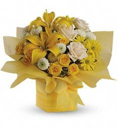 As refreshing as lemon sherbet, this sunny array of flowers in a yellow gift box tied with a matching ribbon makes a tantalizing gift for someone with taste.