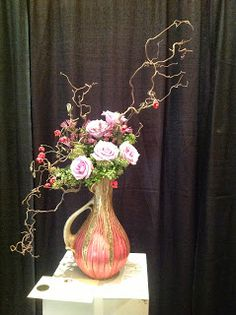 Creative Design with roses, hearts abustin, and Harry lauter. #flower arrangement floral design gardenclubjournal.blogspot.com