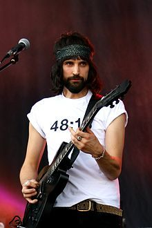 """Sergio Lorenzo """"Serge"""" Pizzorno-- (born 15 December 1980) is a British guitarist, music producer and songwriter, best known for his work with the rock band Kasabian.[1] He is Kasabian's lead songwriter since the departure of Christopher Karloff. He is also a member of Loose Tapestries alongside Noel Fielding and Kasabian touring member Tim Carter, a group put together to produce music for Fielding's TV series Noel Fielding's Luxury Comedy. Noel Fielding's Luxury Comedy, Don Mclean, Goth Bands, Music Film, Fit Motivation, Too Cool For School, Event Photography, Photojournalism, Hard Rock"""