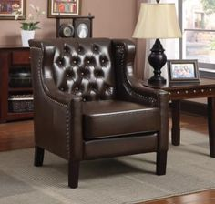 Tufted Wing Back Accent Chair $499.99 Sku:104293 Dimensions:34Wx34Dx28H This wing and tufted back accent chair features a nail head trim with espresso legs. upholstered in a beautiful rich chocolate faux leather this chair is perfect for a study or library. Please visit our website for warranty and benefits.
