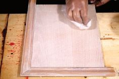 After painting the surfaces, wipe the excess from the wood using paper towels.