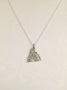 Beautiful Simplistic Slice of Pizza Necklace.This is a wonderful unique and…