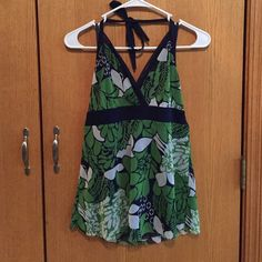 Tie around neck navy, green, and white halter top Navy blue, Green, and white tie around neck halter top in sizes medium and small. Medium has tags. Both never worn. New York & Company Tops Tank Tops