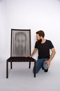 Made of birch wood and jute webbing, this simple chair actually has an artistic detail: an illusion of the designers face created out of the slatted backrest.