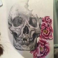 Finished the skull (only took me like 10 weeks wayhay) anyway this weekend I'm gonna paint the last flower and its dunzo. This is a2 size by the way. #wip #pencil #details #illustration #nofilter #realism #skull #peony