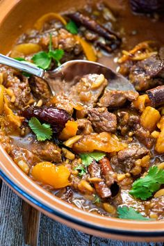 This Lamb Tagine with Dates and Apricots has coriander, cinnamon and saffron mixed with the onion, garlic and almonds that simmer and the lamb is beyond tender. Morrocan Lamb Stew, Morrocan Food, Moroccan Dishes, Moroccan Recipes, Lamb Tagine Recipe, Beef Tagine, Lamb Recipes, Meat Recipes, Mexican Food Recipes