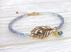 Peacock Jewelry Bracelet, Gold-filled,  Natural Bronze, Feather, Tanzanite Quartz Gemstone Rondelles, Gift For Her, Etsy Gift, Under 40. $38.00, via Etsy.