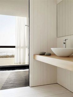 Perfect simple bathroom! © Mauricio Fuertes via archdaily #paintedwallcladding #cladding #timber