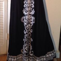 """EMBELLISHED BLACK MAXI SKIRT Spectacular black maxiskirt embellished with silver sequins(all intact, none are missing). White embroidery down the front center and all along the hem. Back of skirt is plain black. Size M but will fit larger. Waist measures 30"""" and 40"""" stretched. Length 40"""". 100% rayon. INC International Concepts Skirts Maxi"""