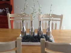 Upcycle tray centerpiece...I used empty wine bottles sprayed with krylon glass paint, a $.50 tray from the thrift store, decorative stones I had on hand,  and I divided up a floral stem from Hobby Lobby.  Project total was less than $10.00.