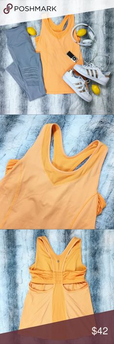Lululemon 🍋 Tangerine Turbo Tank Selling this beautiful tangerine Turbo Tank by Lululemon! 🍋 It has a beautiful back design and comes with a bra support inside. Worn only a couple times, still in very great condition!! 😘💋 lululemon athletica Tops Tank Tops