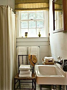 Love the idea of using an antique chair to hold some pretty towels! I just got a beautiful antique chair and I will recreate this!