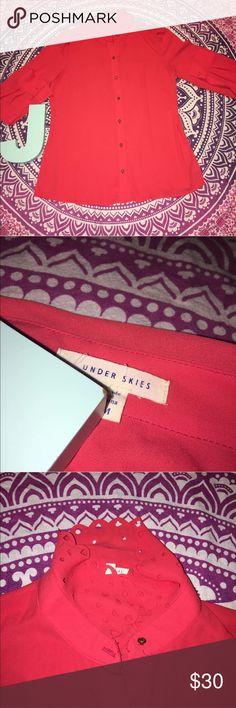 "Stitch Fix Under Skies Red Orange Button Shirt Stitch Fix Under Skies Women's Button Front Shirt. Red Orange. Gold buttons. One sleeve button missing. Cutouts along collar. Longer fit. Size medium. Shoulder to Shoulder: 16"" Pit to Pit: 17.5"" Pit to Sleeve: 16"" Under Skies Tops Button Down Shirts"