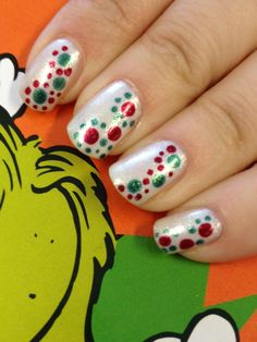 Base is China Glaze Frosty dotted with a large and small dotting tool, red and green polishes from color club