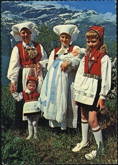 Postcard • National Costume from Hardanger, Norway • Hardanger is a traditional district in the W. part of Norway, dominated by the Hardangerfjord & its inner branches of the Sørfjorden &  Eidfjorden. It consists of the municipalities of Odda, Ullensvang, Eidfjord, Ulvik, Granvin, Kvam & Jondal & is located inside the county of Hordaland.